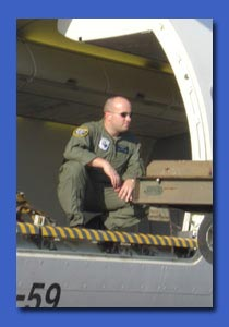 Loadmaster in action, unloading some cargo.